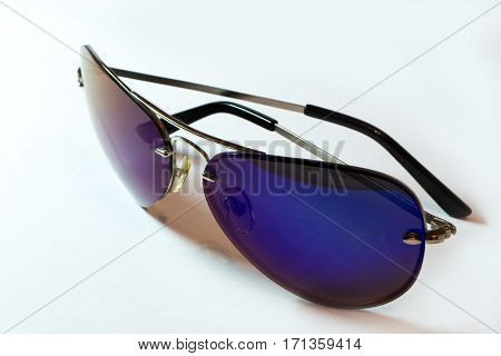 Beautiful ultraviolet sunglasses aviator isolated on white background side view