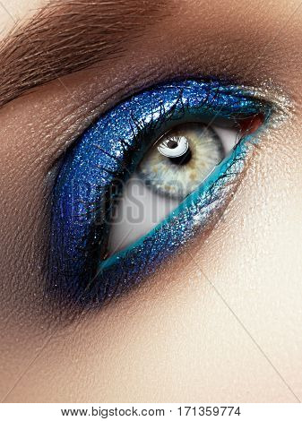 Eye Makeup. Beautiful Eyes Glitter Make-up. Holiday Makeup Detail.