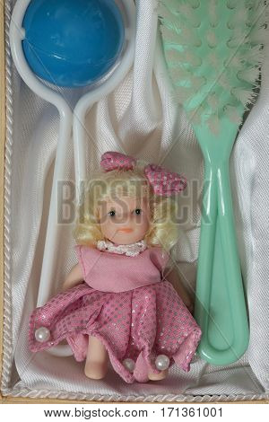 Doll Brush rattle present in the open box top view