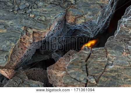 Fire at the crack of frozen lava field at the Tolbachik volcano, after eruption in 2012, Klyuchevskaya Group of Volcanoes