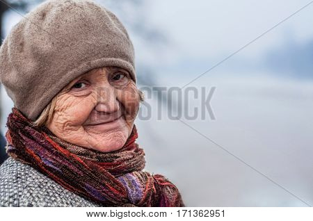 Older cute blonde woman in 60 years