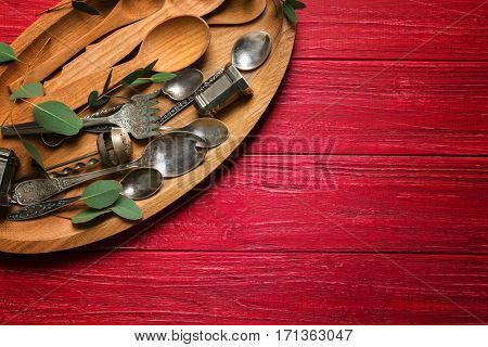 Tray with vintage cutlery on wooden table