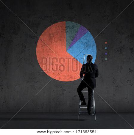 Businessman standing on stepladder over diagram background. Business, success, progress, concept.