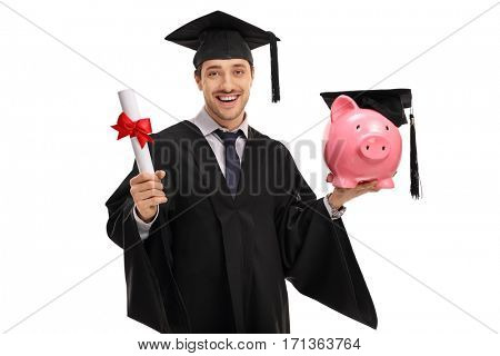 Joyful graduate student holding a diploma and a piggybank with a mortarboard isolated on white background
