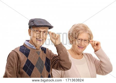 Mature man and a mature woman smiling and looking at the camera isolated on white background