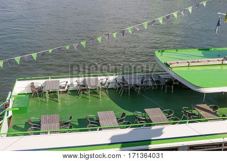 Excursion ship with empty seats and tables expect passengers