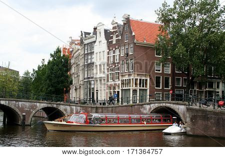 Netherlands Amsterdam June 2016: A canalboat sails on the Keizersgracht