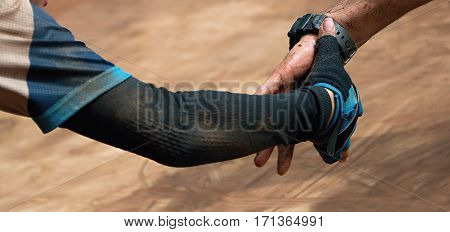 Couple hold hands,help when overcoming hindrances mud race runners
