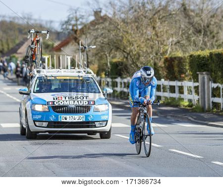 Conflans-Sainte-HonorineFrance-March 62016: The French cyclist Roman Combaud of Delko-Marseille Provence-KTM Team riding during the prologue stage of Paris-Nice 2016.