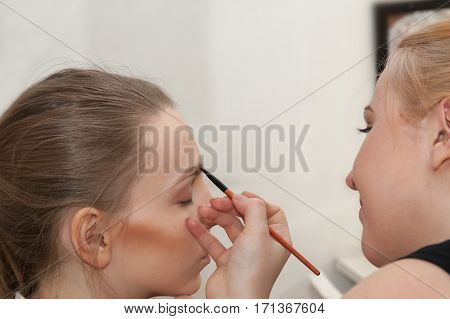 Makeup Artist Apply Makeup Young Girl Before The Photoshoot
