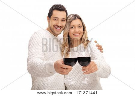 Joyful young couple making a toast with glasses of wine isolated on white background