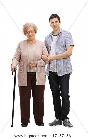 Full length portrait of an elderly lady with a walking cane and a young man helping her isolated on white background