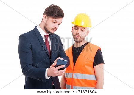 Male Constructor And Businessman Browsing On Cellphone