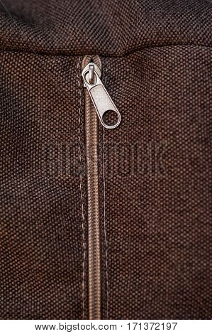 texture of brown fabric with zipper for background.