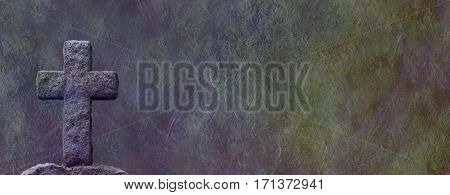 Stone Cross on rough stone background - dark masonry cross against a wide dark multicolored rough rock background with plenty of copy space