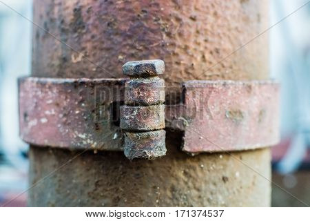 the bolts on old rustic steel column