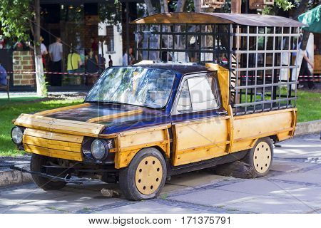 Lvov, Ukraine - July 23, 2016: Retro car chipped wood with an iron cage for protection and transportation prisoners behind