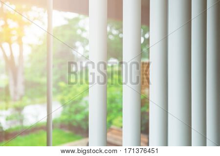 Rising sun behind window blinds in morning