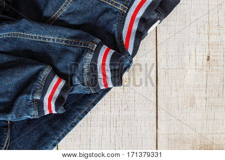 jackets of jeans on a wooden floor.