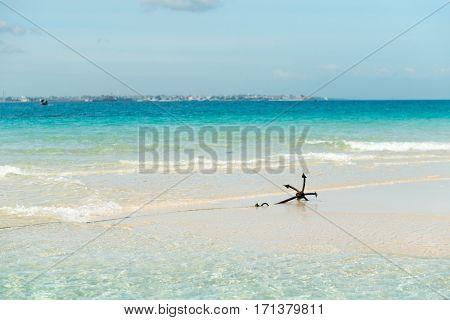 colorful seascape with anchor on Zanzibar coastline and horizon on the background