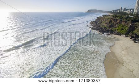 Aerial view of Miami Headland facing south looking at Burleigh beach and headland at sunrise. Gold Coast, Australia
