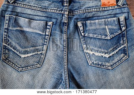 The rear surface of the old jeans.