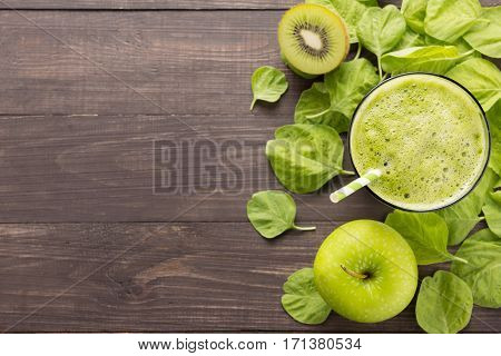 Healthy Green Smoothie With Kiwi, Apple On Rustic Wood Background