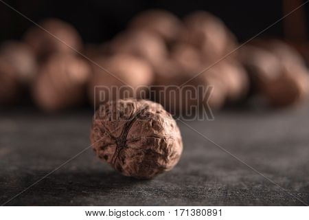 Image of a walnut over dark background