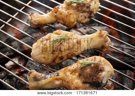 Grilled Chicken Drumstick Over Flames On A Barbecue
