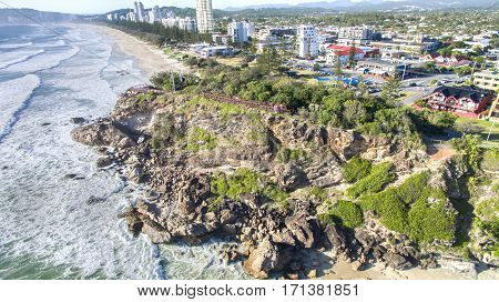 Aerial view of Miami Headland lookout and beach as the sun hits the shoreline. Gold Coast, Australia