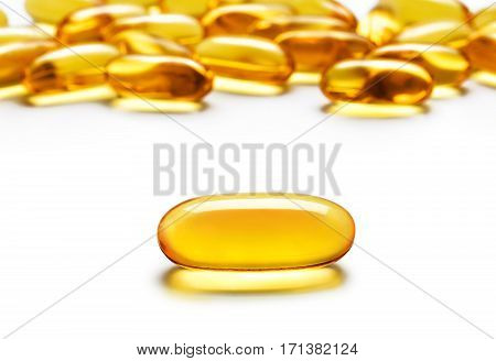 Close up one capsule Omega 3 and many other of capsules isolated on white background. High resolution product. Health care concept