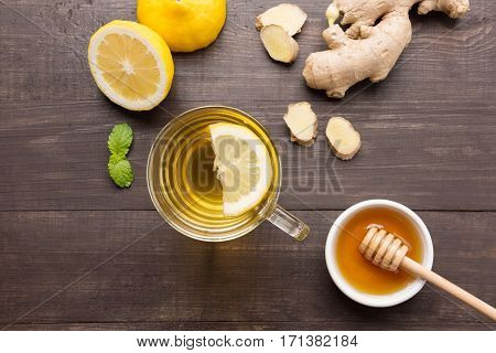 Cup Of Ginger Tea With Lemon, Ginger, Honey On Wooden Background