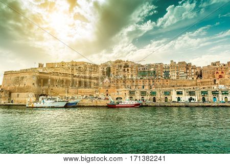great landscape with Valletta embankment and ships with beautiful sky on the background, view fron the sea, Malta