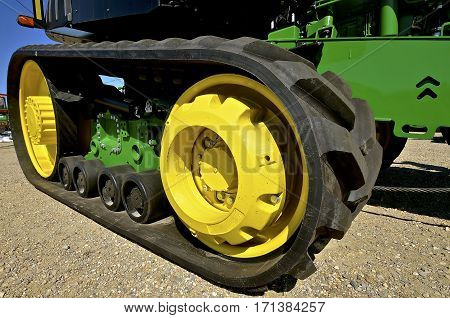 The new and unused track of a tractor which replaces the original round front and rear wheels