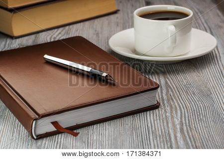 Closed Notebook With Fountain Pen On Rustic Table. Pen On Notebook.