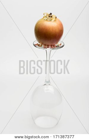 Apple On Wineglass With Pills And Capsule
