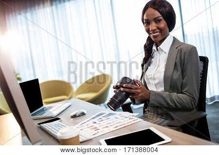 Businesswoman using a camera in the office