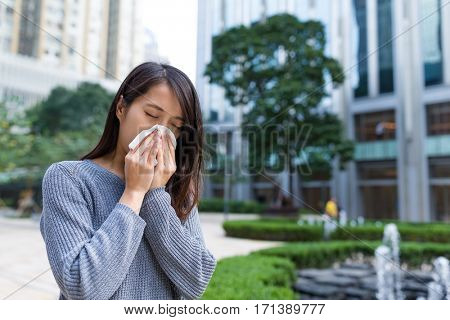 Woman with nose allergy
