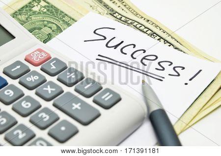 Hand Written Success Word On Paper