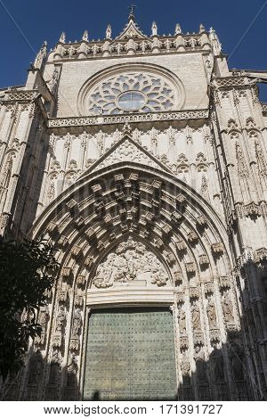 Sevilla (Andalucia Spain): a door of the cathedral with statues