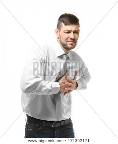 Young man having heart attack on white background