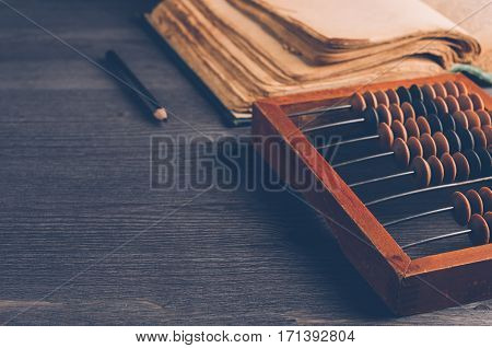 Old Wooden Abacus On Dark Background. The Concept Of Bookkeeping, Business Or Saving Money
