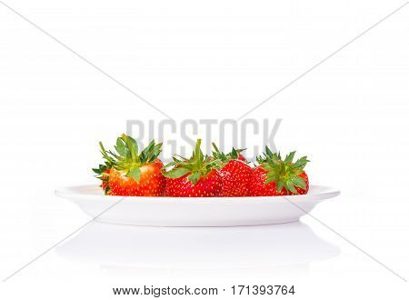 fresh red stawberries in a white plate on isolated white background room for copyspace