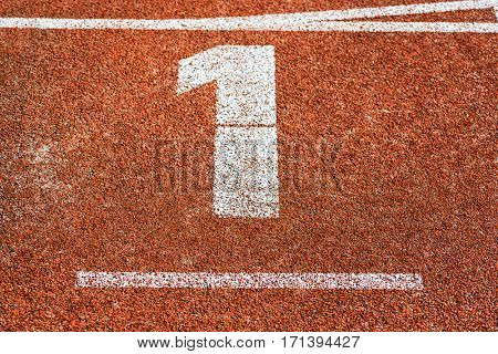 Start number one at cinder track of track and field running track