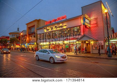 San Francisco, California, United States - August 14, 2016: twilight on Jefferson road. Waterfront of Fisherman's Wharf. Holidays, lifestyle and nigthlife concept. Urban street view and cityscape.