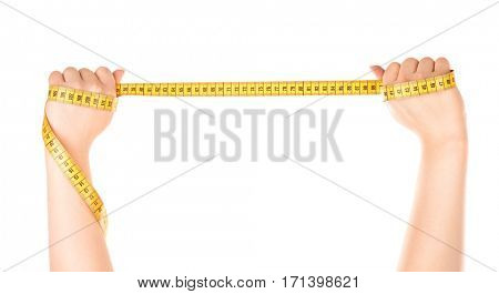 Female hands holding measuring tape on white background