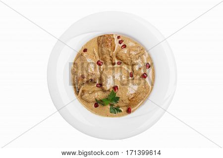 fried chicken in walnut sauce traditional Georgian dish white background top view isolated