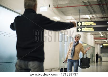 Old guy picking up his woman at the airport