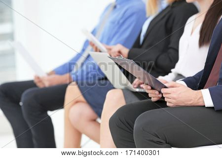 Group of people waiting for job interview, closeup
