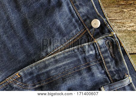 A fly in blue denim jeans, background